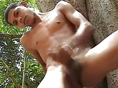 Latin Twink jacks off outside