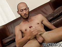 Bald Spanish twink Dominic Arrow strokes his fat cock solo