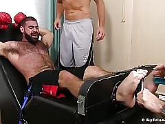 Hunk boxer Ricky Larkin is tied up by Sergey and his friend