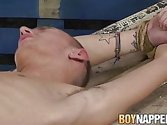 Skinny young Reece Bentley restrained for blowjob BDSM