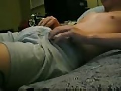 Boy wanks on bed