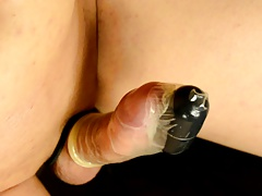 Cumshot with a vibrator in between two condoms
