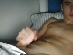 Cute guy jerks off on cam