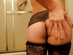 Sexy Crossdresser shaking HOT ass in stockings and skirt