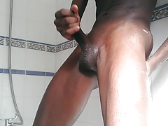 Black twink masturbating in the shower